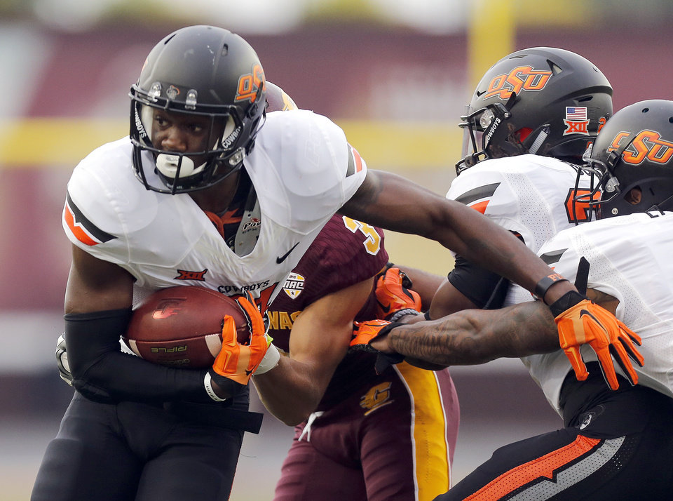 Photo - Oklahoma State's Tre Flowers (31) returns an interception in the first quarter during the college football game between the Central Michigan Chippewas and the Oklahoma State University Cowboys at the Kelly-Shorts Stadium in Mount Pleasant, Mich., Thursday, Sept. 3, 2015. Photo by Sarah Phipps, The Oklahoman