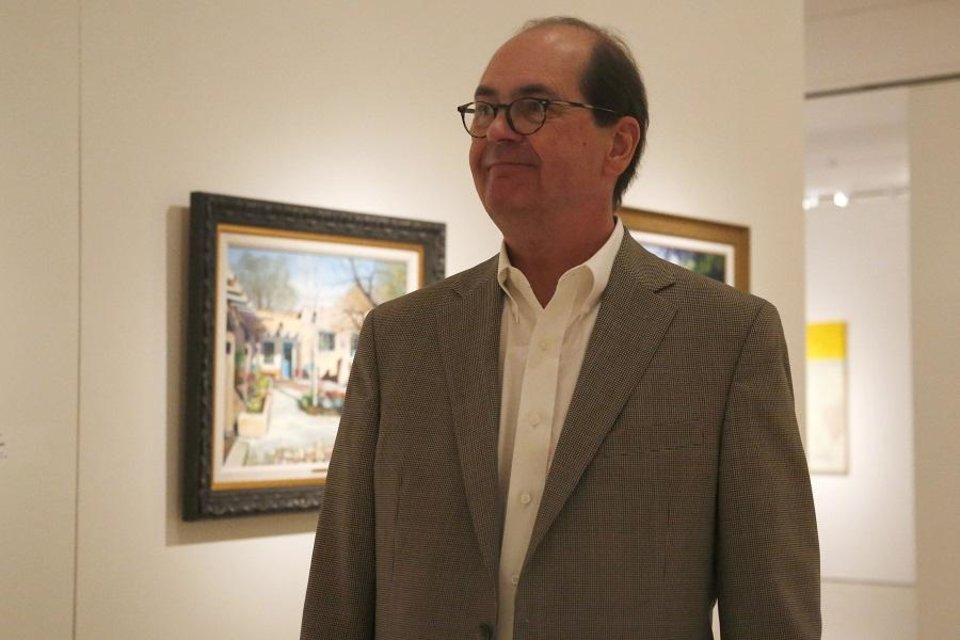 "Photo - Nick Berry, a member of the Oklahoma Society of Impressionists, talks about the artwork by 22 Oklahoma artists is displayed in the exhibit ""Between the Isms: The Oklahoma Society of Impressionists and Selected Oklahoma Expressionists"" at the Fred Jones Jr. Museum of Art in Norman Oklahoma on July 11, 2019. The exhibit is on view through Sept. 8. [Paxson Haws/The Oklahoman]"