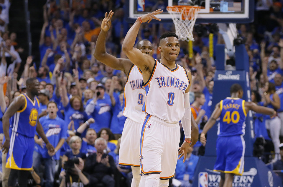 Photo - Oklahoma City's Russell Westbrook (0) celebrates after a 3-pointer during Game 3 of the Western Conference finals in the NBA playoffs between the Oklahoma City Thunder and the Golden State Warriors at Chesapeake Energy Arena in Oklahoma City, Sunday, May 22, 2016. Oklahoma City won 133-105. Photo by Bryan Terry, The Oklahoman