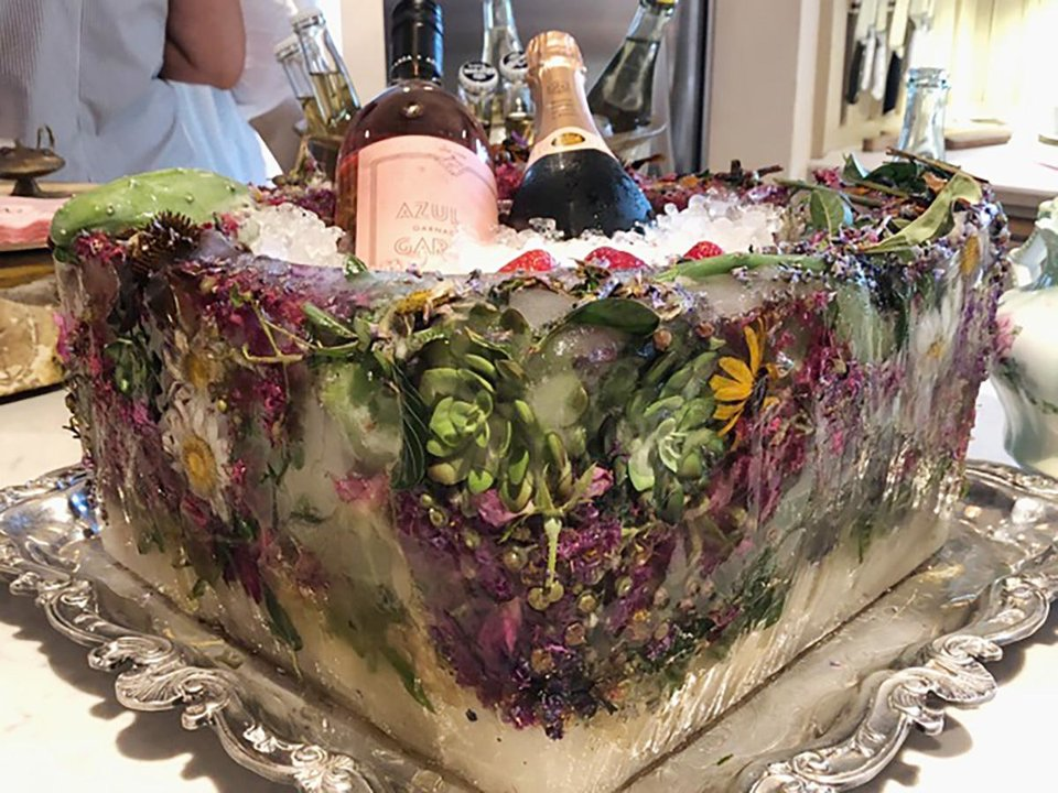 Photo - Ice sculpture wine cooler inlaid with cactus and flowers. PHOTO PROVIDED