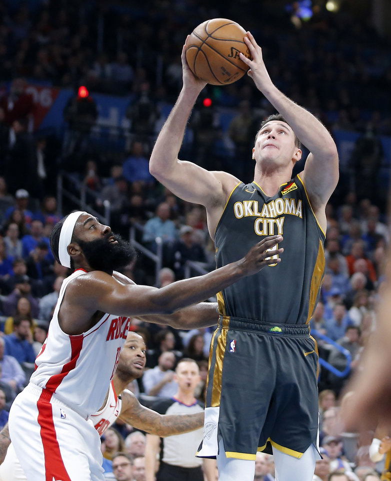 Photo - Oklahoma City's Danilo Gallinari (8) attempts a shot beside Houston's James Harden (13) during an NBA basketball game between the Oklahoma City Thunder and Houston Rockets at Chesapeake Energy Arena in Oklahoma City, Thursday, Jan. 9, 2020. [Bryan Terry/The Oklahoman]