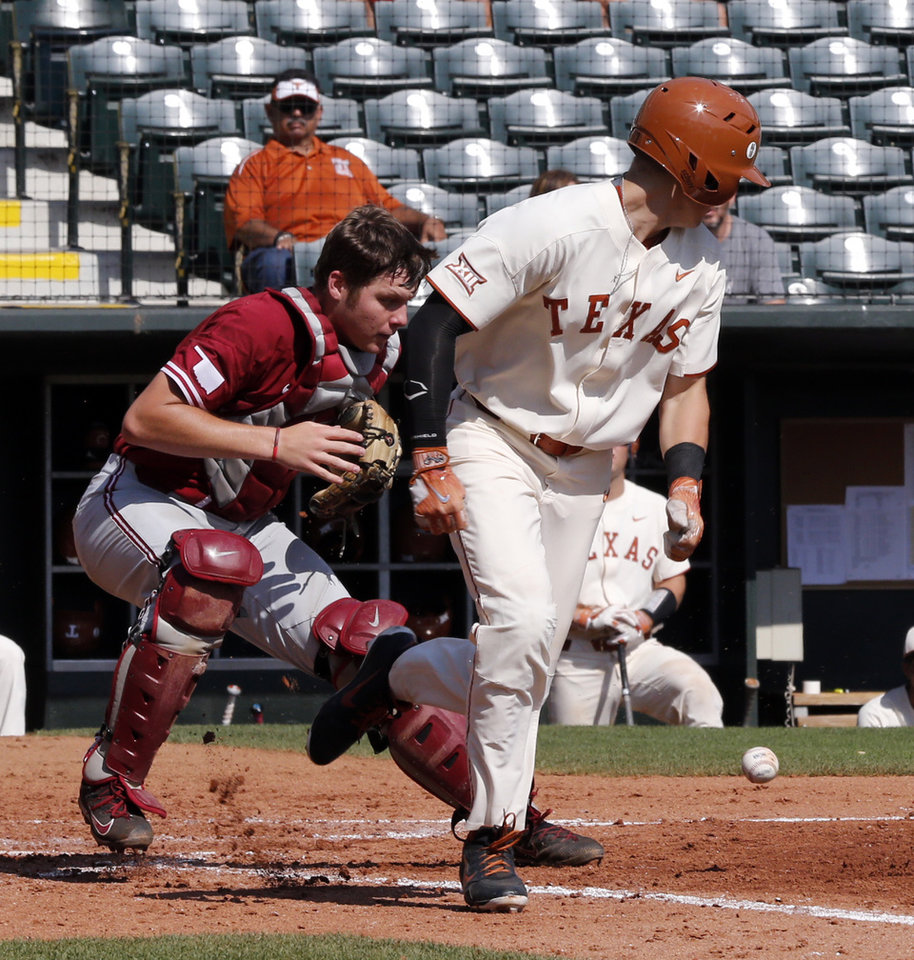 Oklahoma catcher Brady Lindsly lets a bunt by Texas infielder Masen  Hibbeler roll backwards and go foul as the University of Oklahoma Sooners ( OU) play the ... ee2d6bdde