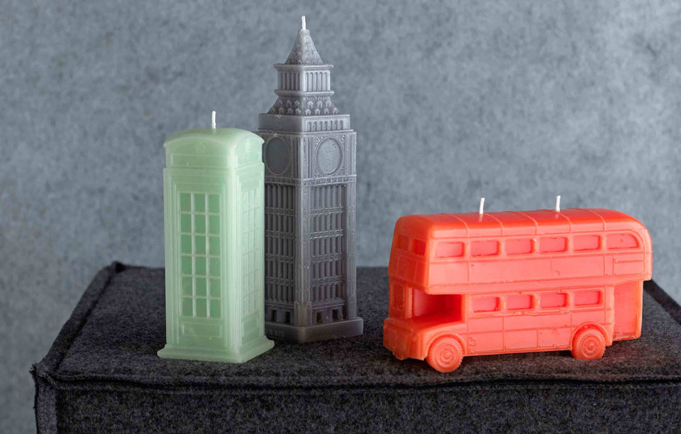 Photo - This product image courtesy of Bliss Living Home shows British inspired novelty candles. While Paris has been dear to home decorators for several years, we're seeing the look of London more and more in the newest furnishings and accessories.    (AP Photo/Bliss Living Home)