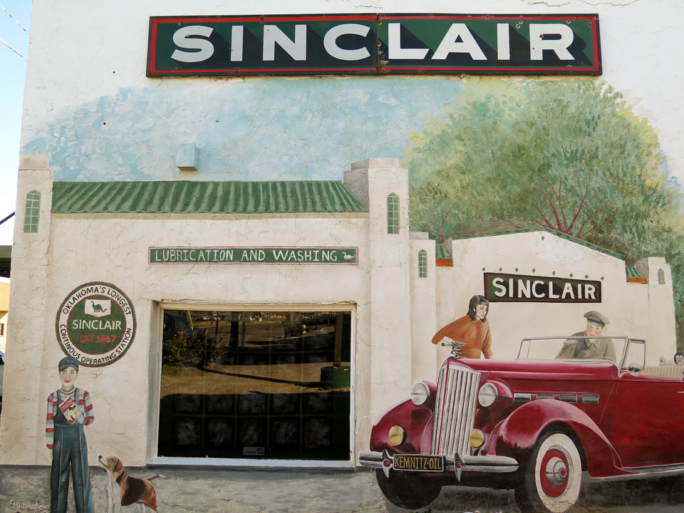Photo -  A mural is shown on a building owned by the Kemnitz Oil Co. Inc. in Perry on Feb. 3, 2016. The Kemnitz Sinclair Station is the oldest continuously operated service station in Oklahoma. [Photos by Paul Monies, The Oklahoman]
