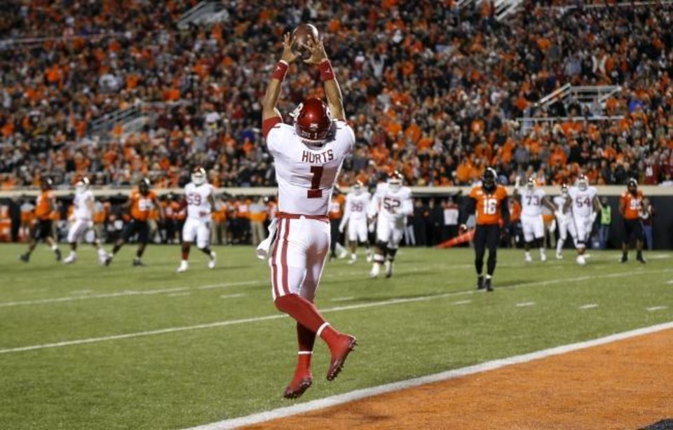 Photo -  Oklahoma quarterback Jalen Hurts (1) catches — yes, catches — a touchdown pass from Nick Basquine in the first half of a 34-16 win against Oklahoma State on Saturday in Stillwater. [Nate Billings/The Oklahoman]