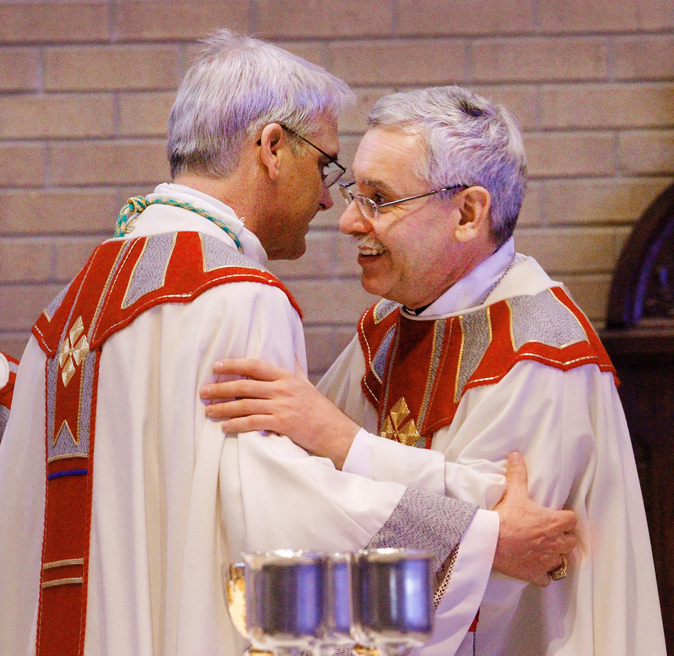 Parishioners express feelings for oklahoma citys new archbishop photo archbishop paul coakley left exchanges a collegial greeting with bishop anthony taylor m4hsunfo Image collections