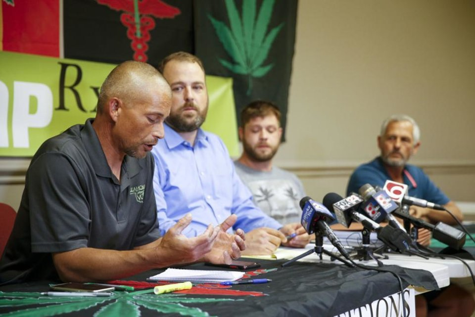 Photo - President of Green the Vote Issac Caviness speaks to reporters during a press conference on regulations on SQ-788 at HempRX on Friday, July 13, 2018. IAN MAULE/Tulsa World