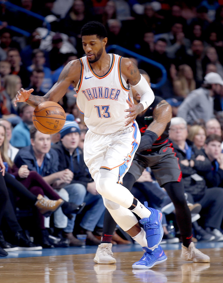Photo - Oklahoma City's Paul George (13) gets a loose ball during the NBA basketball game between the Oklahoma City Thunder and the Portland Trail Blazers at Chesapeake Energy Arena in Oklahoma City, Tuesday, Jan. 22, 2019. Photo by Sarah Phipps, The Oklahoman