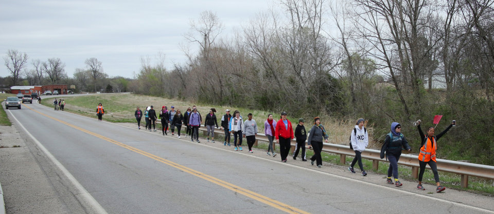 Photo - March for Public Education by Tulsa teachers, students and supporters, who are walking to the Capitol from Tulsa along SH 66, Sunday, April 8, 2018. Photo by Doug Hoke, The Oklahoman