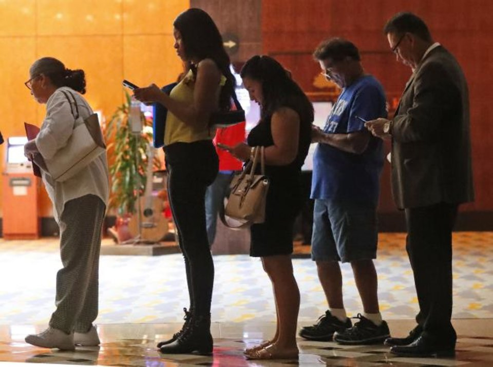 Photo -  Job applicants wait in line at the Seminole Hard Rock Hotel & Casino Hollywood during a job fair in Hollywood, Florida. [AP PHOTO]