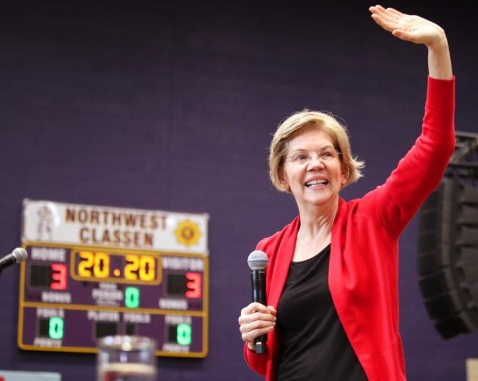 Photo -  Democratic presidential candidate Elizabeth Warren waves to the crowd at Northwest Classen High School, her alma mater. [Doug Hoke/The Oklahoman]