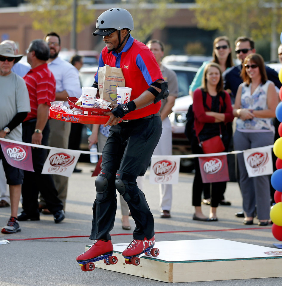 skate it off news ok sonic carhop alex clack of oklahoma city skates through an obstacle course during the sonic skate off competition in oklahoma city wednesday 26