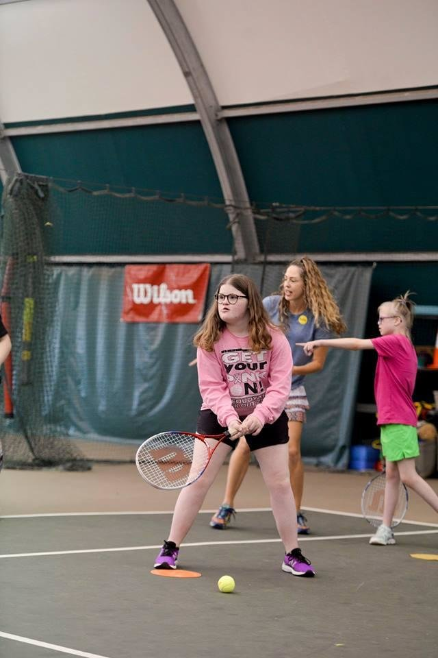 Photo - Addison Klehm prepares to return a serve during the We Are Champions Tennis Clinic. [PHOTO PROVIDED]