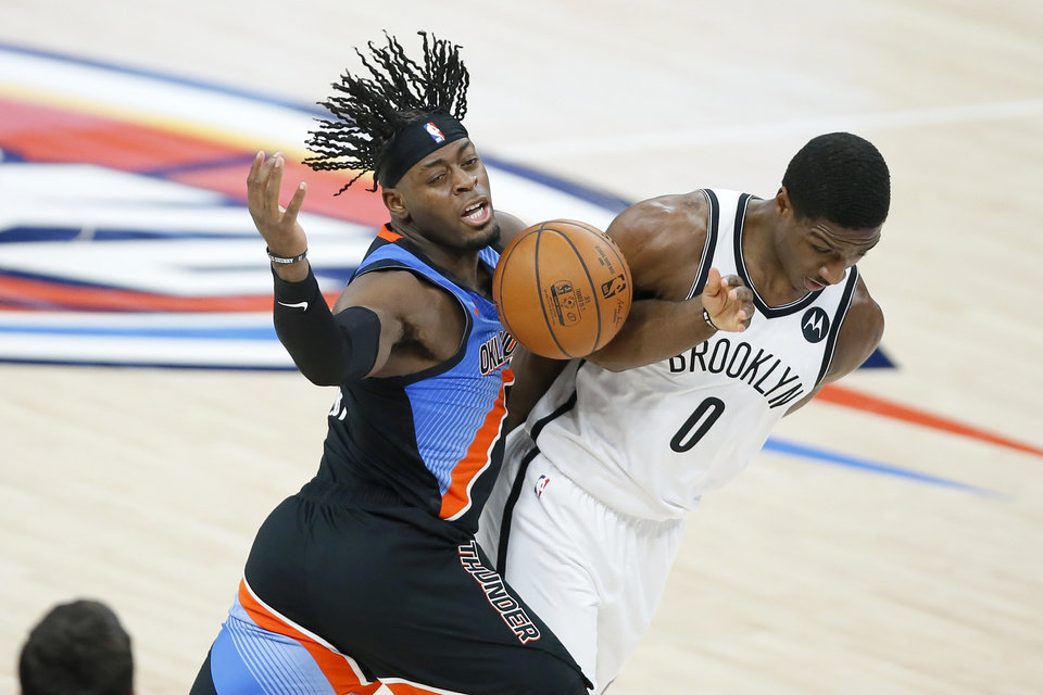 Photo - Oklahoma City's Luguentz Dort (5) is fouled by Brooklyn's Reggie Perry (0) during an NBA basketball game between the Oklahoma City Thunder and the Brooklyn Nets at Chesapeake Energy Arena in Oklahoma City, Friday, Jan. 29, 2021. [Bryan Terry/The Oklahoman]