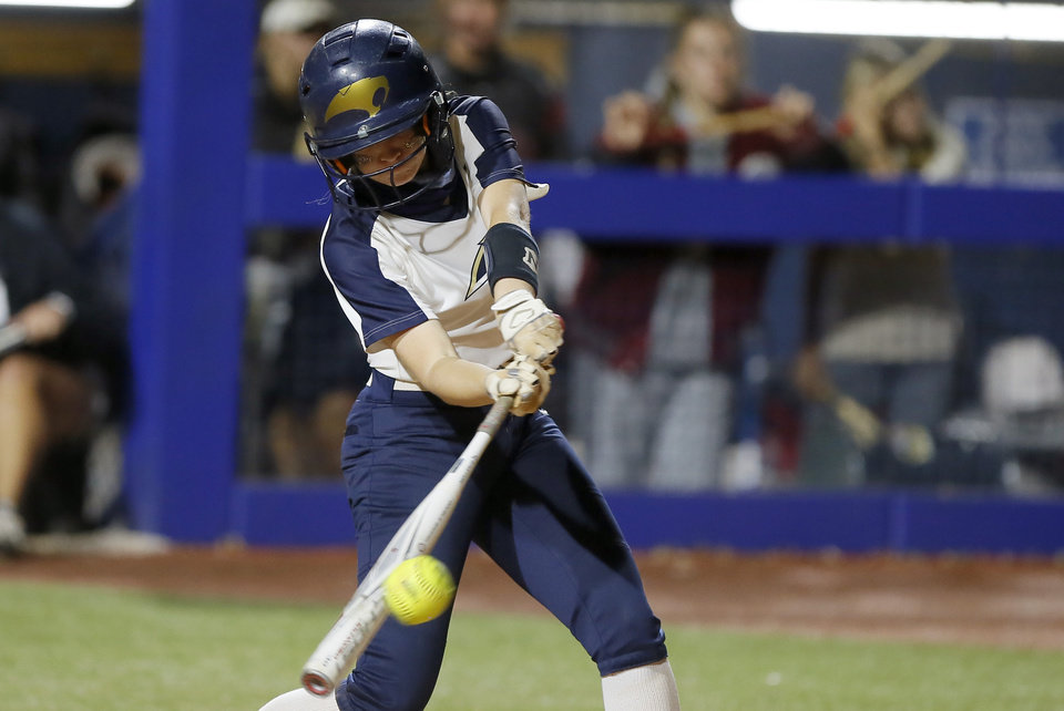 Photo - Southmoore's Riley Sharp drives in the game-winning run during the Class 6A state softball championship game between Southmoore and Owasso at USA Softball Hall of Fame Stadium in Oklahoma City, Saturday, Oct. 17, 2020. [Bryan Terry/The Oklahoman]