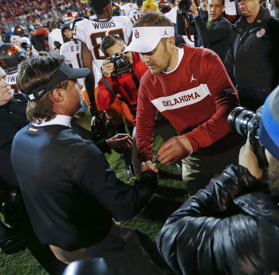 Photo - OSU coach Mike Gundy and OU coach Lincoln Riley shake hands after a Bedlam college football game between the University of Oklahoma Sooners (OU) and the Oklahoma State University Cowboys (OSU) at Gaylord Family-Oklahoma Memorial Stadium in Norman, Okla., Nov. 10, 2018. OU won 48-47. Photo by Nate Billings, The Oklahoman
