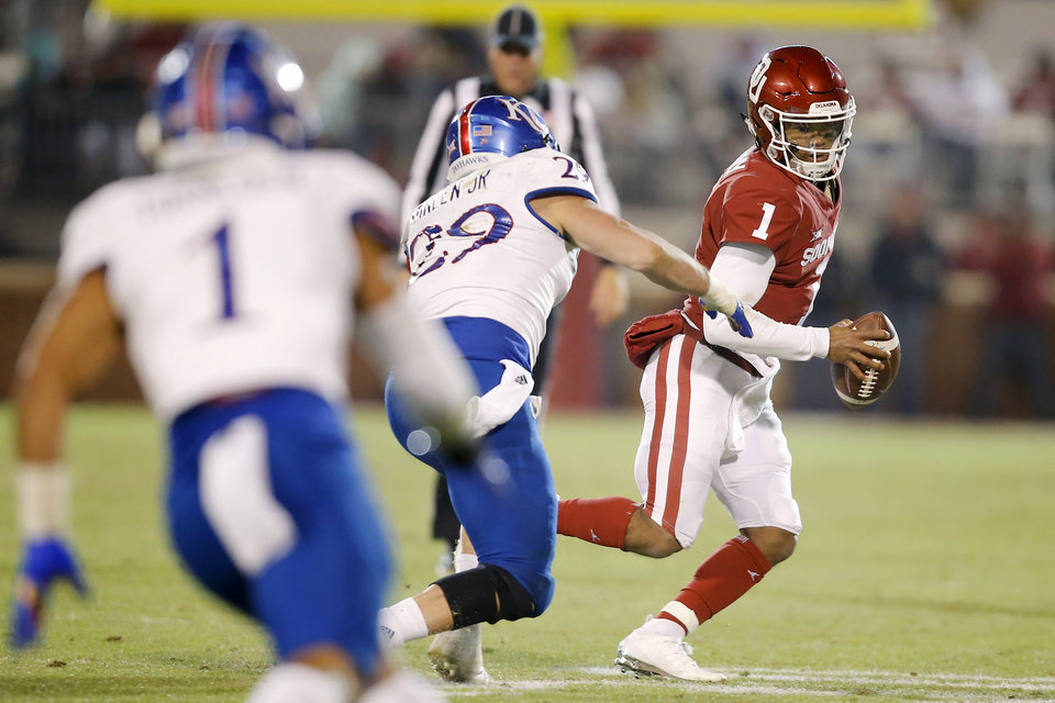 Photo - Oklahoma's Kyler Murray (1) tries to scramble away from Kansas' Joe Dineen Jr. (29) during a college football game between the University of Oklahoma Sooners (OU) and the Kansas Jayhawks (KU) at Gaylord Family-Oklahoma Memorial Stadium in Norman, Okla., Saturday, Nov. 17, 2018. Photo by Bryan Terry, The Oklahoman