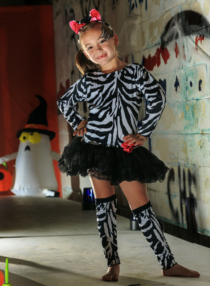 Photo - Maddie is a charming little zebra in this costume that comes with a tutu dress, tail, leg warmers and headpiece. Costume from Party Galaxy.  Makeup by Ashley Tolman, The Makeup Room Agency.  Photo by Chris Landsberger, The Oklahoman  CHRIS LANDSBERGER