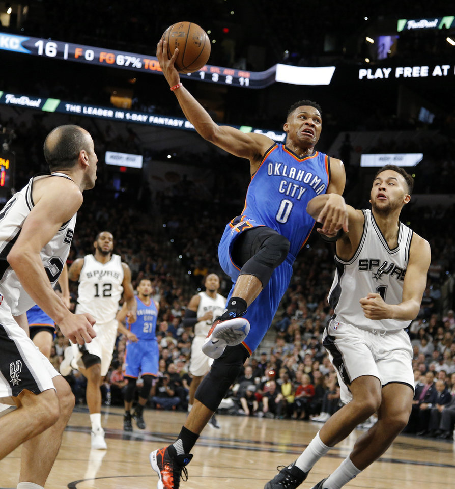 Photo - Oklahoma City's Russell Westbrook (0) goes to the basket between San Antonio's Kyle Anderson (1) and Manu Ginobili (20) during Game 2 of the second-round series between the Oklahoma City Thunder and the San Antonio Spurs in the NBA playoffs at the AT&T Center in San Antonio, Monday, May 2, 2016. Photo by Bryan Terry, The Oklahoman
