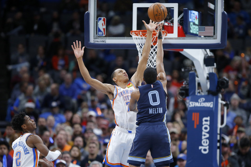 Photo - Oklahoma City's Darius Bazley (7) blocks the shot of Memphis' De'Anthony Melton (0) during an NBA basketball game between the Oklahoma City Thunder and the Memphis Grizzlies at Chesapeake Energy Arena in Oklahoma City, Wednesday, Dec. 18, 2019. Oklahoma City won 126-122. [Bryan Terry/The Oklahoman]