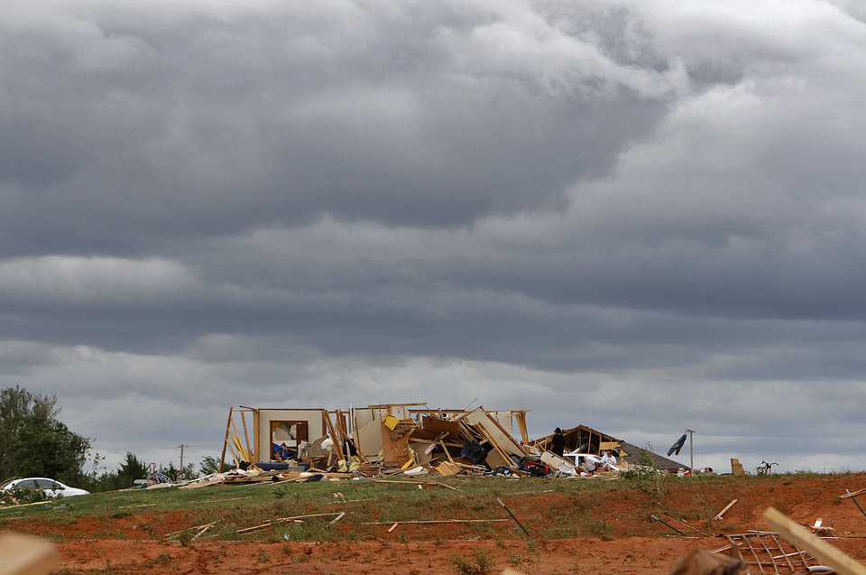 Photo - The shell of a home is the only thing that remains after being hit by a tornado on Tuesday west of El Reno, Wednesday, May 25, 2011. Photo by Chris Landsberger, The Oklahoman