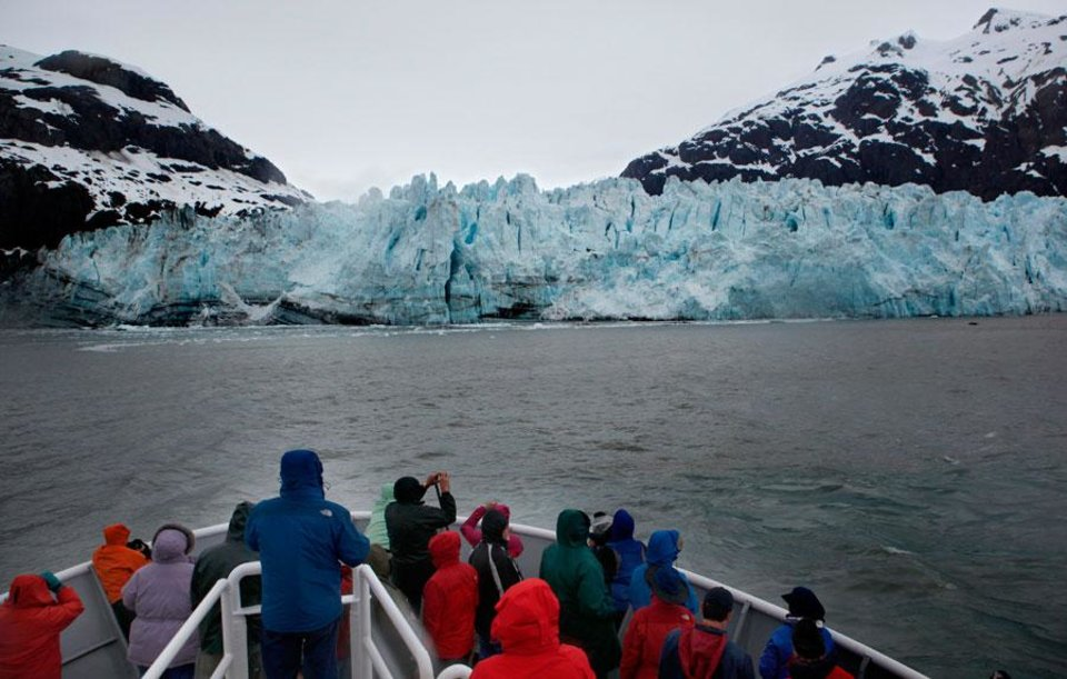Photo -  People observe the Margerie Glacier in Glacier Bay National Park in Alaska, Thursday, June 7, 2012.  Photo by Sarah Phipps, The Oklahoman