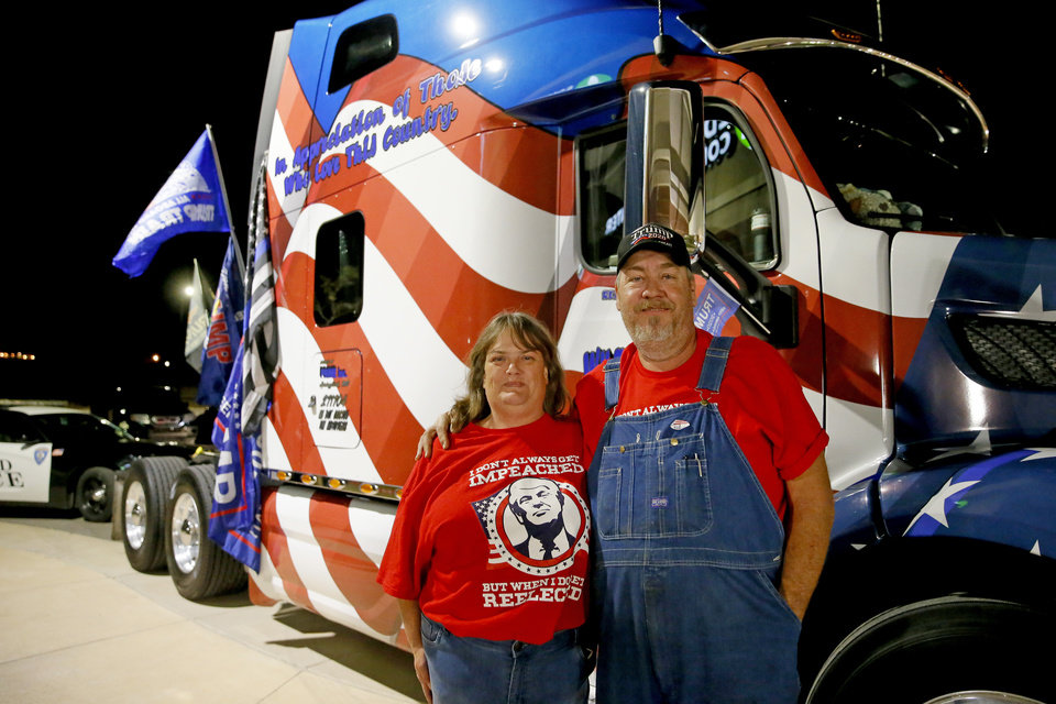 Photo - Robert and Kelley Wooldridge pose by their truck parked outside a Republican Party election night watch party in Edmond, Tuesday, Nov. 3, 2020. [Bryan Terry/The Oklahoman]