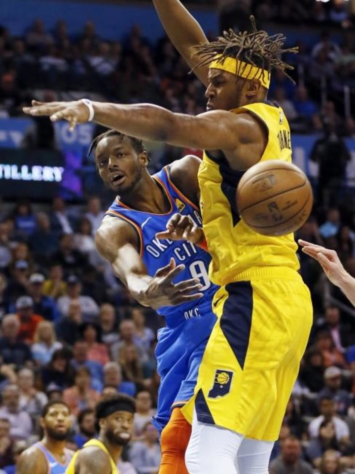 Photo -  Oklahoma City's Jerami Grant (9) passes around Indiana's Myles Turner (33) during the Thunder's 107-99 win over the Pacers Wednesday night at Chesapeake Energy Arena. [Nate Billings/The Oklahoman]