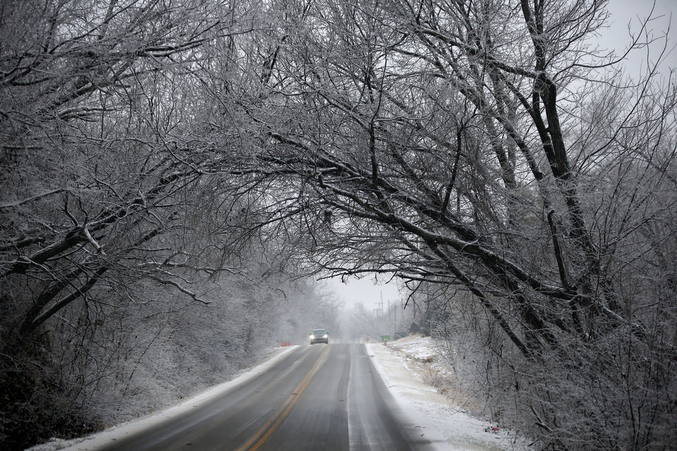 Photo - A car travels east on Covell Road in Edmond, Okla.,   Thursday, Jan. 3, 2019. Photo by Sarah Phipps, The Oklahoman