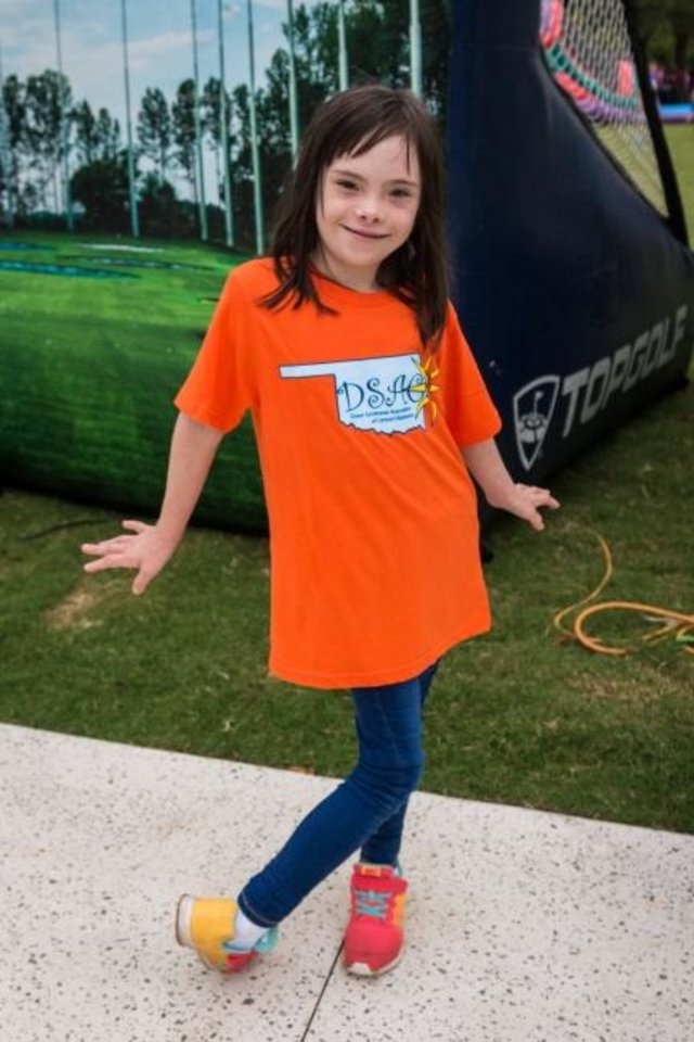 Photo -  Lily Hennen models her Down Syndrome Association of Central Oklahoma shirt at the 2019 Down Syndrome Festival and 5K. [PHOTO PROVIDED]