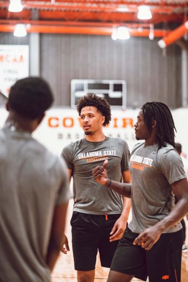 Photo -  Oklahoma State freshman Cade Cunningham, center, and junior Isaac Likekele are expected to lead the Cowboys this season. [Courtney Bay/OSU Athletics]