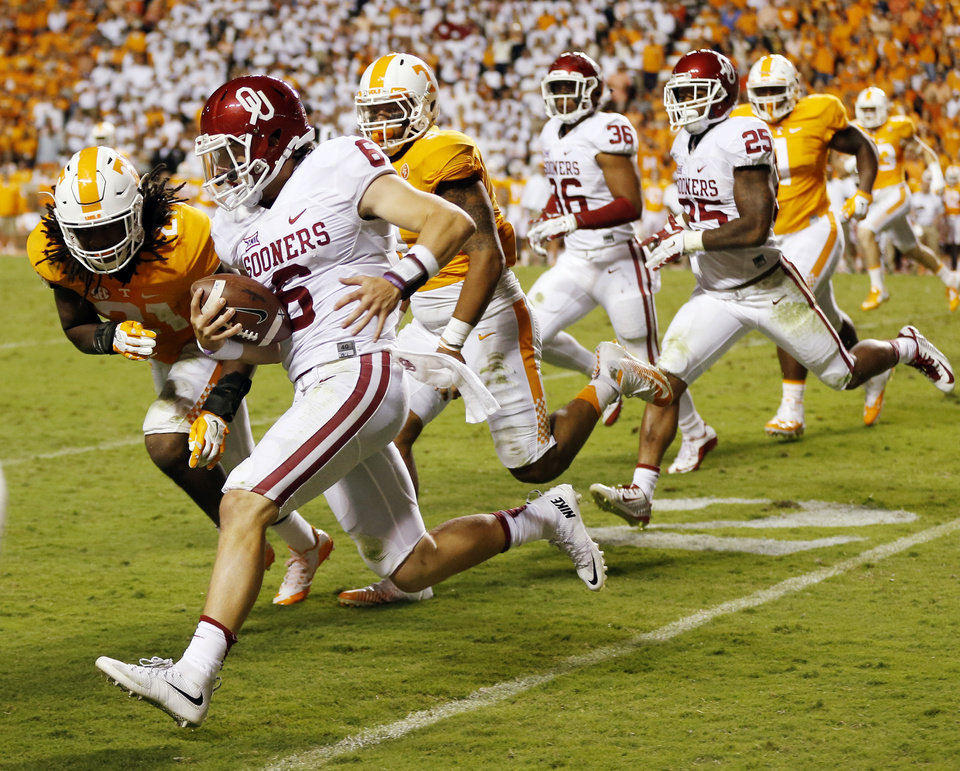 Photo - Oklahoma's Baker Mayfield (6) carries the ball during the college football game between the Oklahoma Sooners (OU) and the Tennessee Volunteers at Neyland Stadium in Knoxville, Tennessee, Saturday, Sept. 12, 2015. OU won 31-24 in double overtime. Photo by Nate Billings, The Oklahoman