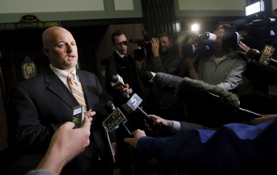 Photo - Brandon Carey, attorney for Oklahoma City Public Schools, speaks to the media after an injunction hearing on the Douglass-Locust Grove football controversy at the Oklahoma County Courthouse in Oklahoma City, Wednesday, Dec. 10, 2014. Photo by Nate Billings, The Oklahoman
