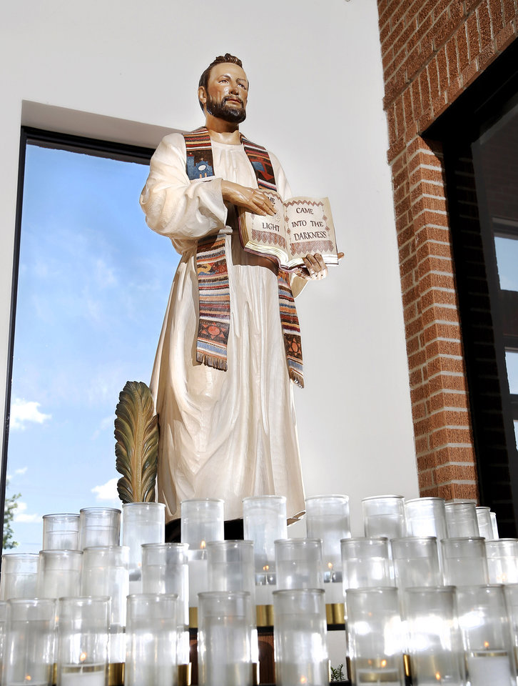 Photo -  A statue and shrine honoring the Rev. Stanley Rother is near the front entrance of St. James the Greater Catholic Church, 4201 S McKinley.  [Photo by Jim Beckel, The Oklahoman]