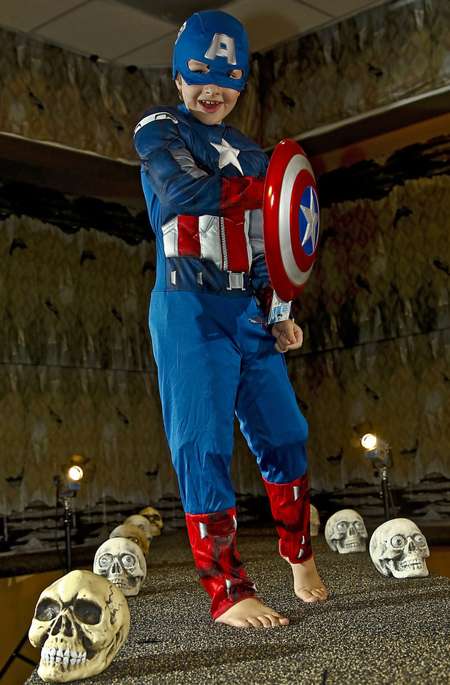 Photo - Captain America costume modeled by Ramey. Costume sold at Party Galaxy. Photo by Chris Landsberger, The Oklahoman  CHRIS LANDSBERGER