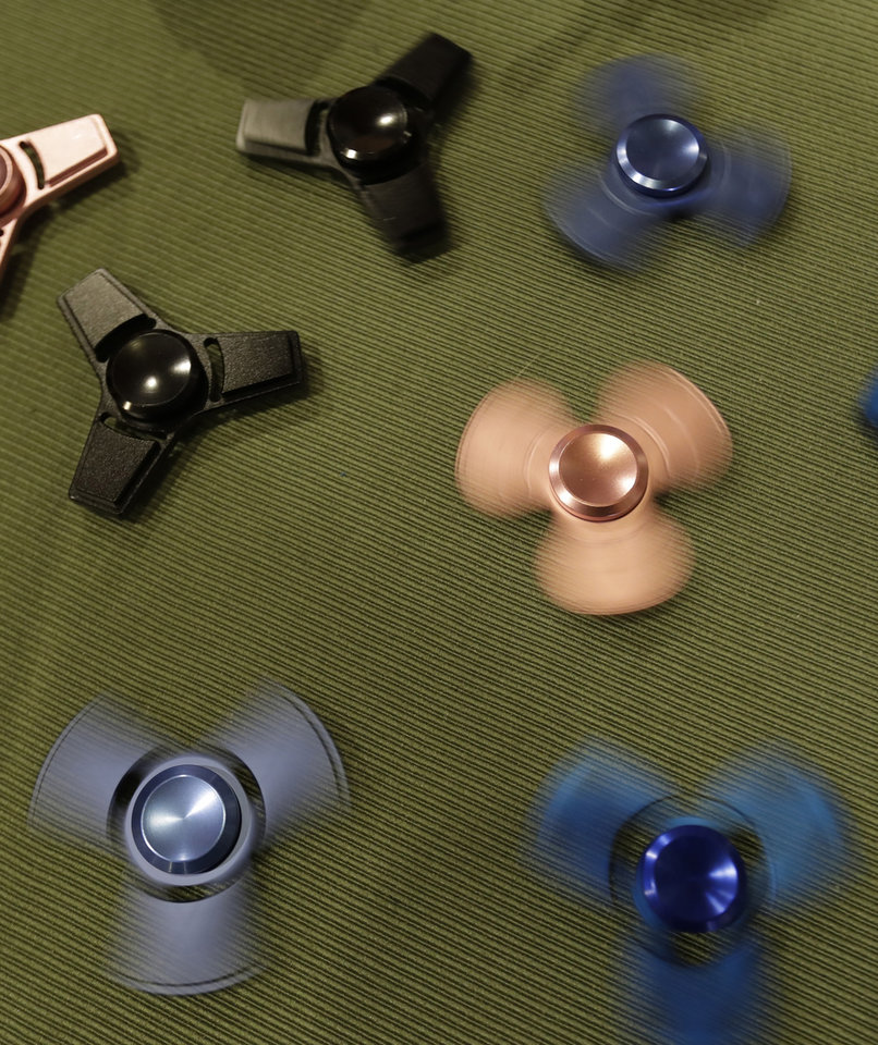 ... Photo - This Thursday, May 11, 2017, photo, shows fidget spinners at