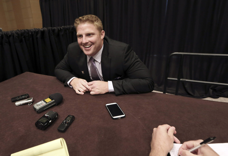 Photo - Kansas State defensive end Ryan Mueller smiles as he speaks to reporters during the NCAA college Big 12 Conference football media days in Dallas, Tuesday, July 22, 2014. (AP Photo)
