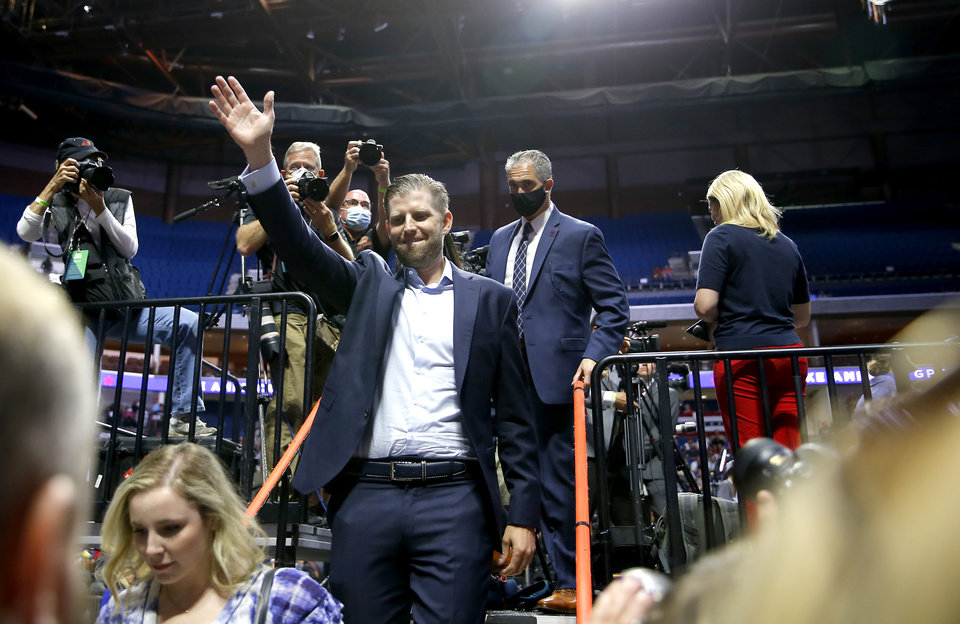 Photo - Eric Trump waves to the crowed before the President Donald Trump Rally at the BOK in Tulsa, Okla., Saturday, June 20, 2020. [Sarah Phipps/The Oklahoman]