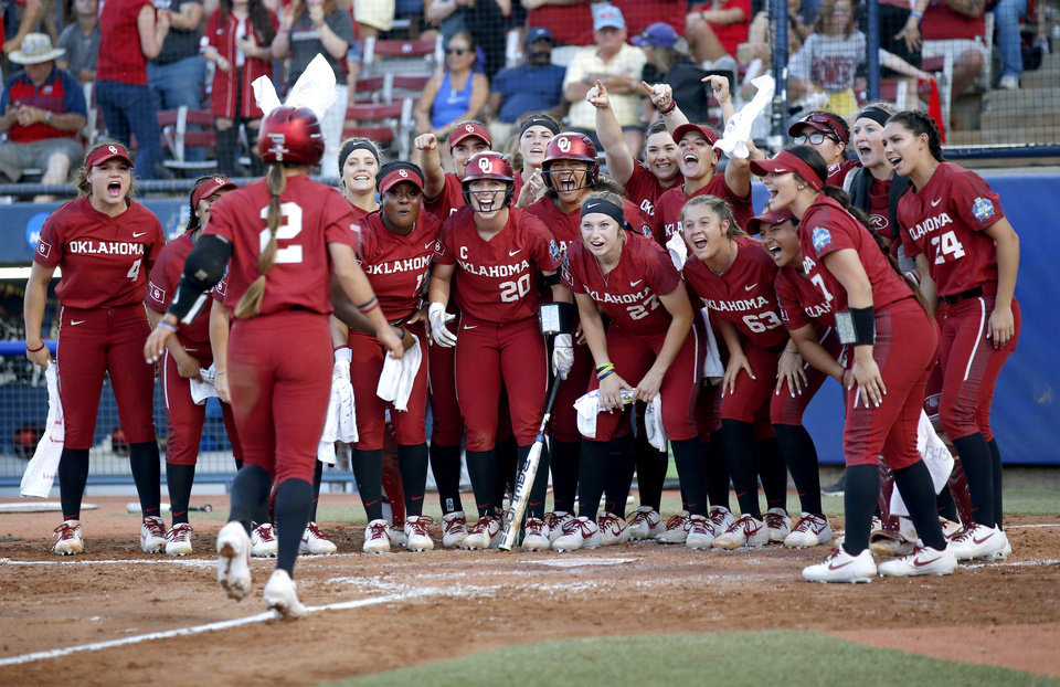 Photo - Oklahoma celebrates a Sydney Romero (2)  home run in the 3rd inning during the second NCAA softball game in the championship series of the Women's College World Series between Oklahoma and UCLA at USA Softball Hall of Fame Stadium in Oklahoma City, Tuesday, June 4, 2019. [Sarah Phipps/The Oklahoman]
