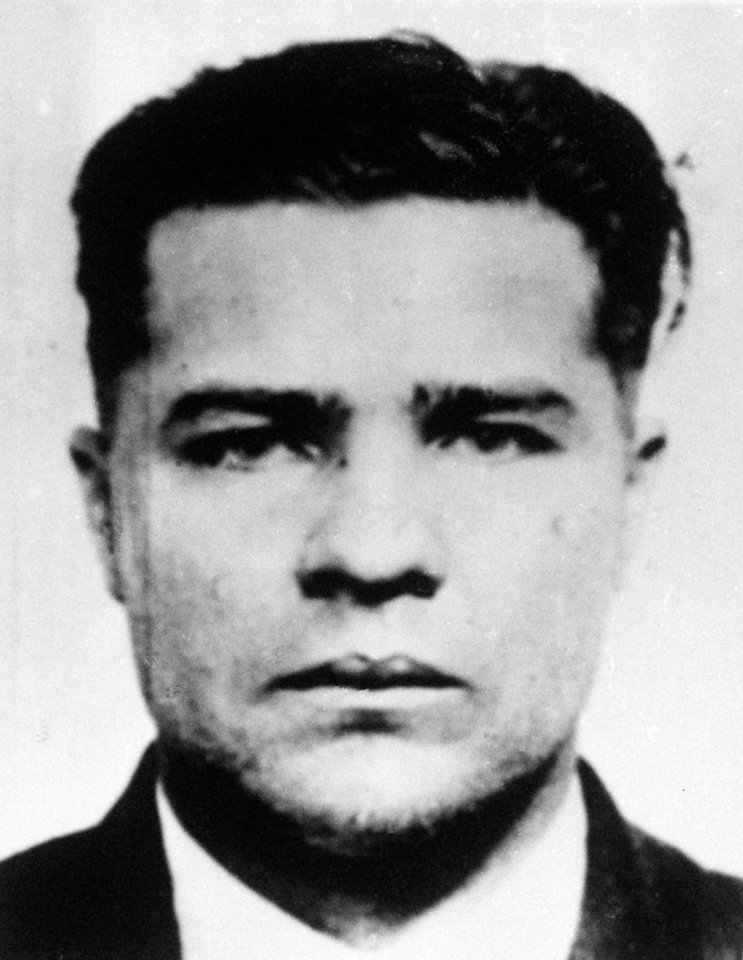 "Photo - **ADVANCE FOR MONDAY FEB 2** Charles ""Pretty Boy"" Floyd is shown in this 1932 photo, location not known. On the centennial of  Floyd's birth, the notorious bank robber and mass murderer is still remembered as a Robin Hood in his home states of Oklahoma and Arkansas, celebrated in pop culture and credited with bringing the FBI to prominence.  Floyd is immortalized in gangster lore and FBI records for the Kansas City Massacre of June 17, 1933, when he and another man shot two Kansas City police officers,two FBI agents and Frank Nash, a criminal Floyd was trying to spring from federal custody. (AP Photo/file)"