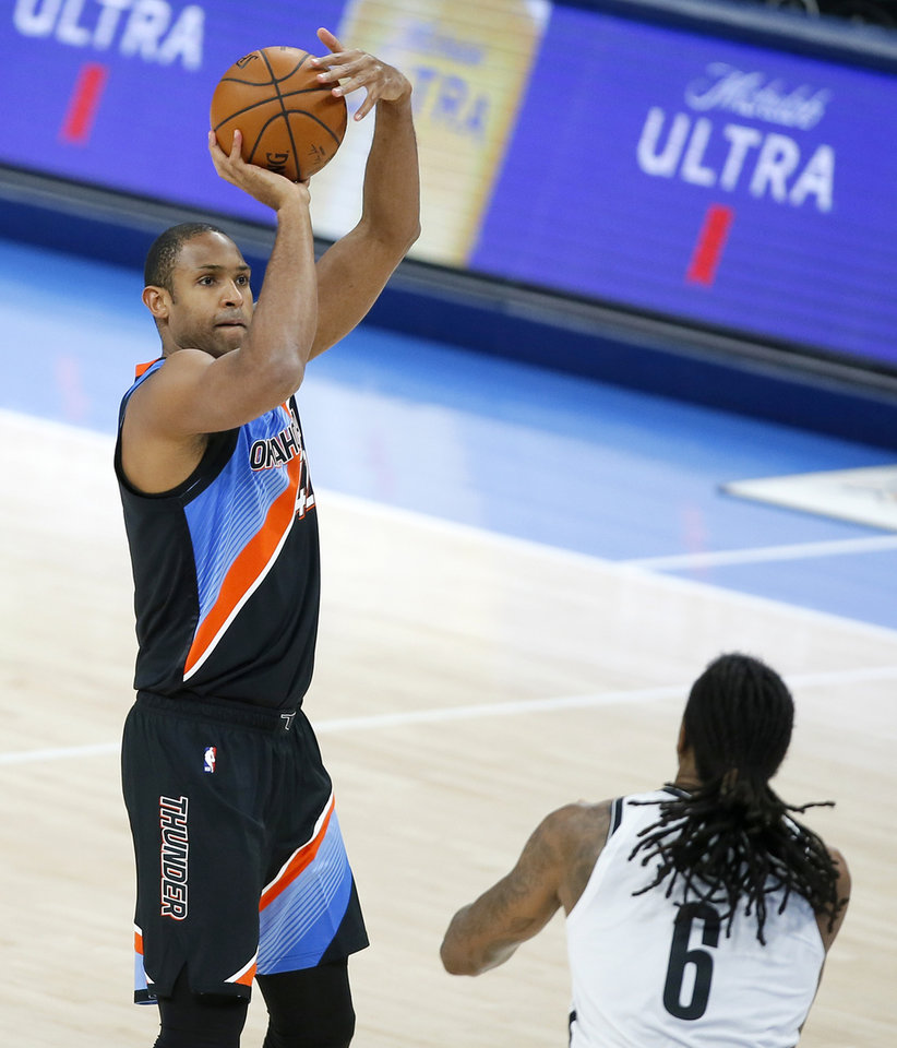 Photo - Oklahoma City's Al Horford (42) shoots a 3-pointer over Brooklyn's DeAndre Jordan (6) during an NBA basketball game between the Oklahoma City Thunder and the Brooklyn Nets at Chesapeake Energy Arena in Oklahoma City, Friday, Jan. 29, 2021. [Bryan Terry/The Oklahoman]