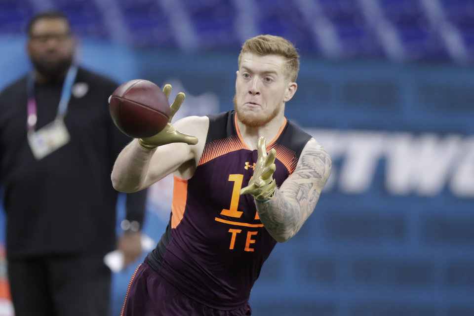 Photo - Texas A&M tight end Jace Sternberger runs a drill at the NFL football scouting combine in Indianapolis, Saturday, March 2, 2019. (AP Photo/Michael Conroy)