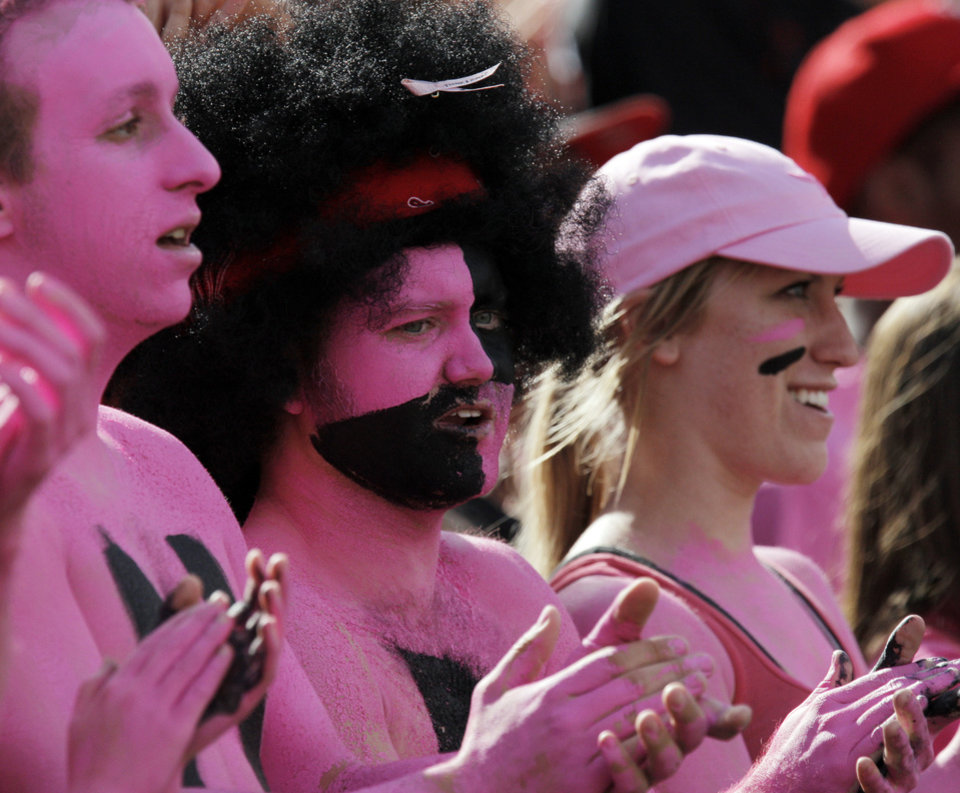 Photo - Texas Tech fans wear pink to support breast cancer awareness during the college football game between the Oklahoma State University Cowboys and Texas Tech University Red Raiders at Jones AT&T Stadium in Lubbock, Texas, Saturday, October 16, 2010. Photo by Nate Billings, The Oklahoman