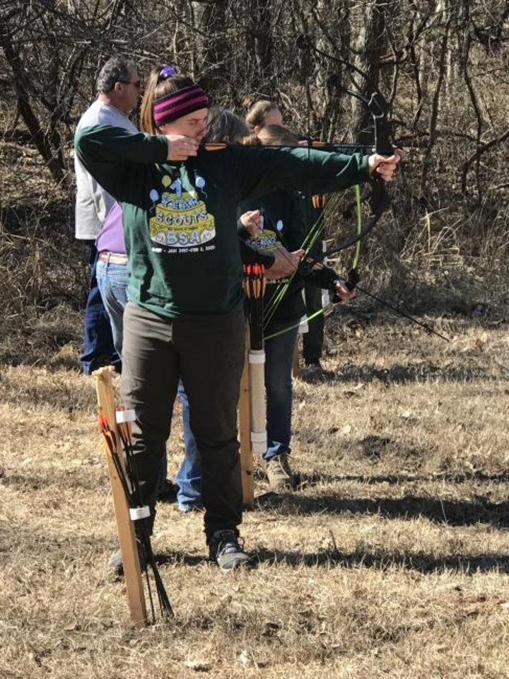 Photo -  Kaydence Brightwell, 14, of Troop 6222 in Noble, participates in an archery lesson during a Scouts BSA campout at the John W. Nichols Scout Ranch in Mustang. [Carla Hinton/The Oklahoman]