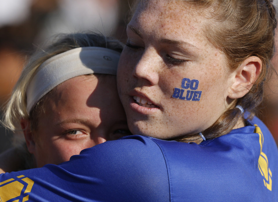 Photo - PHS #25 Ellie Griffin, left, gets a hug from #34Rikki Hadley during the 5A Fast Pitch Championship game between Piedmont and Carl Albert at the Ball Fields at Firelake in Shawnee, Saturday, October 19, 2019. [Doug Hoke/The Oklahoman]