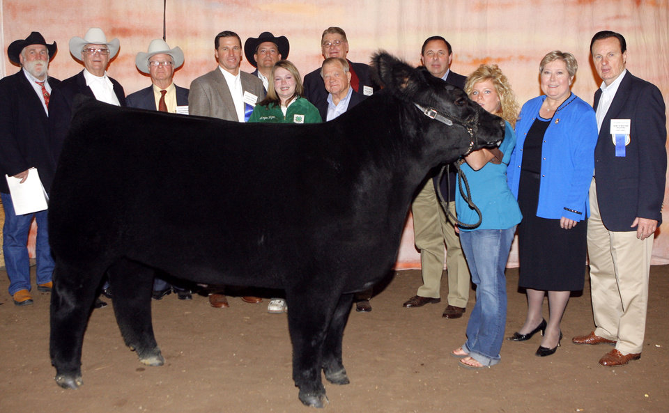 Photo - CATTLE: Grand Champion steer winner Morgan Wynn (in green) with Doug Sauter, Bob Funk, David Terry, Gerald Callahan, Ted Farris, Bob Newcombe, Kevin Yates, Morgan Matlock, Lt. Gov. Jari Askins and Jimmy Harrel during the Sale of Champions of the Oklahoma Youth Expo at State Fair Arena in Oklahoma City, Thursday, March 20, 2008. BY MATT STRASEN, THE OKLAHOMAN ORG XMIT: KOD