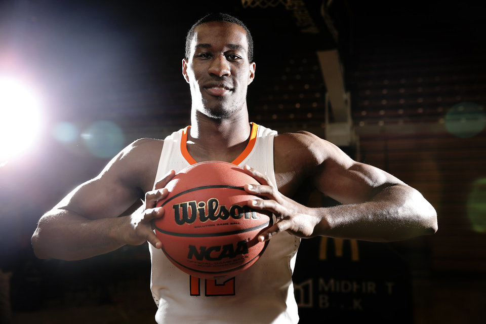 Photo -  Oklahoma State junior Cam McGriff has worked to teach the Cowboys' four freshman forwards leading to Saturday's season opener at Charlotte. [PHOTO BY SARAH PHIPPS, THE OKLAHOMAN]