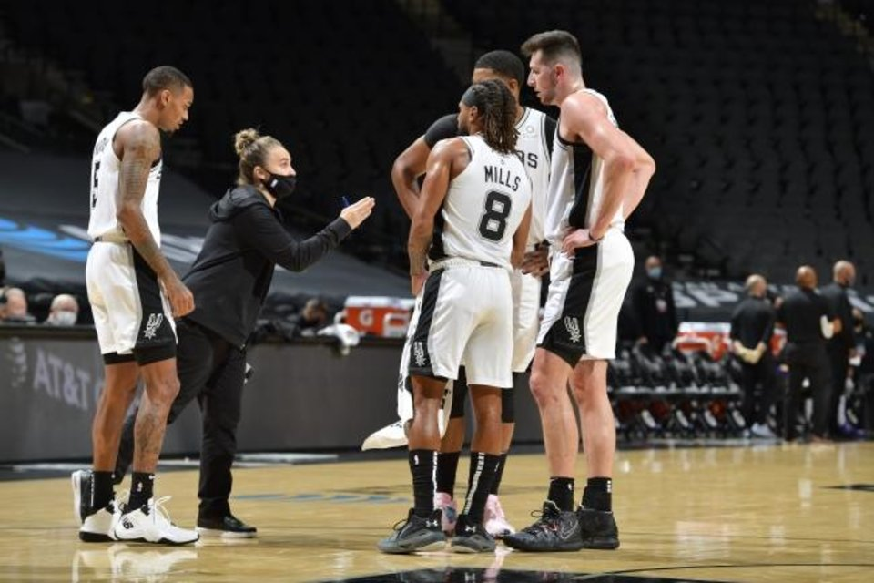 Photo -  Spurs coach Becky Hammon talks to her team during a game against the Lakers on Dec. 30 in San Antonio. Hammon made history when she took over as head coach after Gregg Popovich was ejected. [Logan Riely/NBAE via Getty Images]