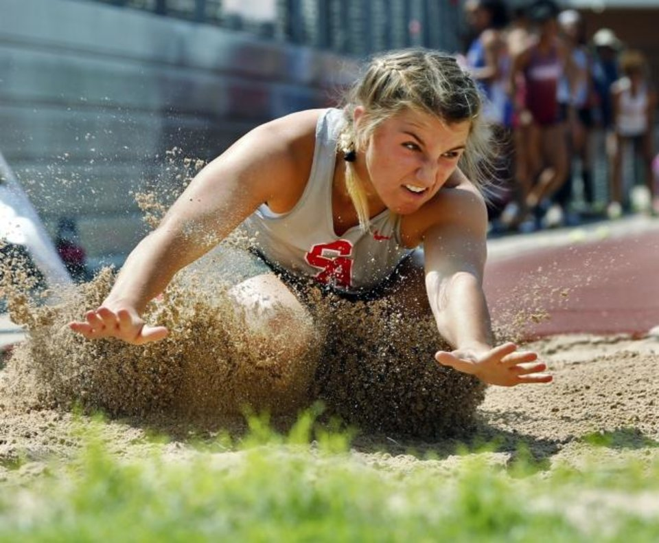 Photo -  Maddy Scott of Carl Albert makes an attempt in the 5A girls long jump at the state track meet last  spring at Yukon High School. [OKLAHOMAN ARCHIVES]