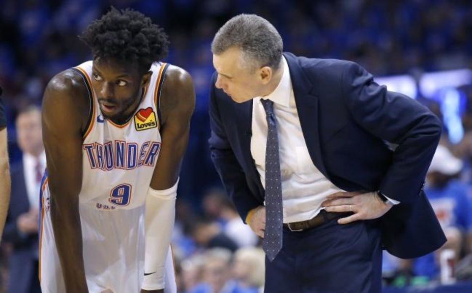 Photo -  Oklahoma City coach Billy Donovan, right, talks with Jerami Grant during Game 4 of a first round playoff series against Porltand on April 21 at Chesapeake Energy Arena. Grant's performance this season was a pleasant surprise for the Thunder. [Sarah Phipps/The Oklahoman]